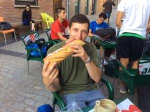 Fellow Pilgrim Eating Large Sandwich.